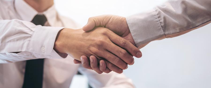Shaking Hands - First Class Surety Bond Service.
